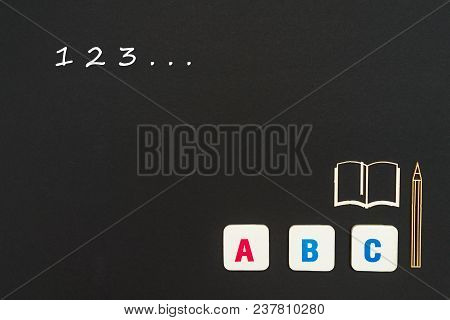 concept english school, numbers 123, abc letters, chipboard miniature book, pen on blackboard poster