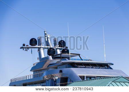 The Upper Decks Of A Luxury Grey Yacht