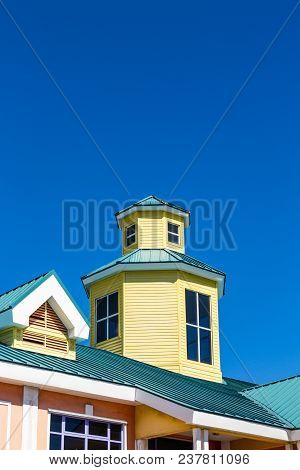A Yellow And Green Wood And Metal Cupola In Nassau Bahamas