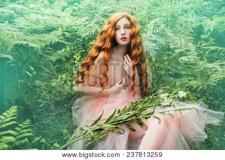 Beautiful Pre-raphaelite Renaissance Girl With Curly Red Hair With A Flying Tulle Renaissance Dress