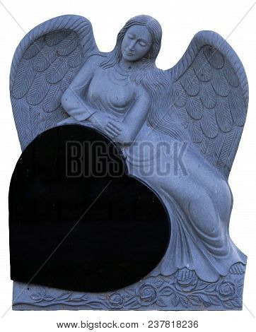 A Female Angel Resting Against An Onyx Black Heart On An Isolated Background.