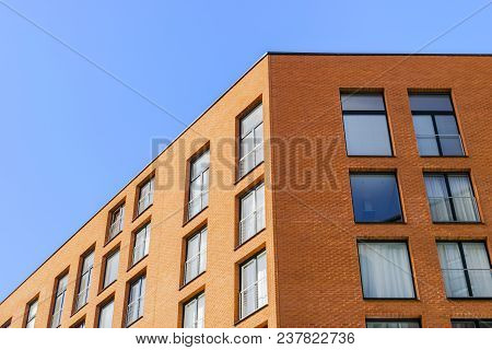 Details Of Office Building Exterior. Business Buildings Skyline Looking Up With Blue Sky. Modern Arc