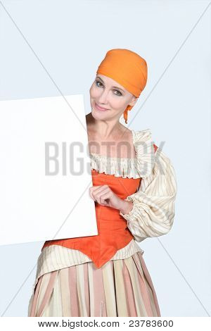 Woman in a theatrical outfit and a board blank for your message