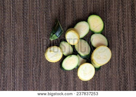 Patterned Background With Several Slices Of Summer Squash And Zucchini Ready To Cook For Dinner.