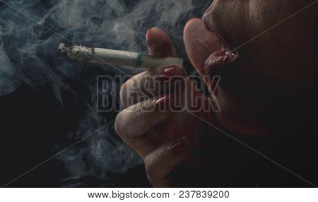 Woman With Red Nail Is Smoking Cigarette On Dark Background. Quit Smoking Concept. Bad Habit In Woma
