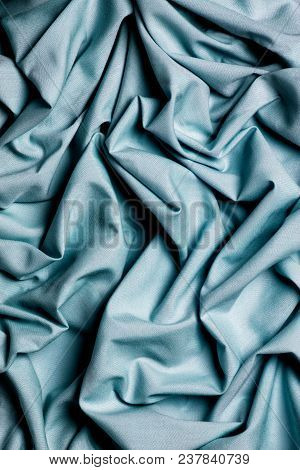 Draping Fabric Cloth Shiny Blue Heavenly Vintage. Wavy Background. A Fabric Heavenly Colored Curves