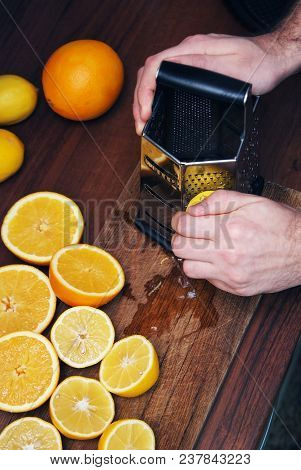 Men Hands Barks Lemon Peel For Lemon Cake. Many Half Cutted Lemons And Citrus