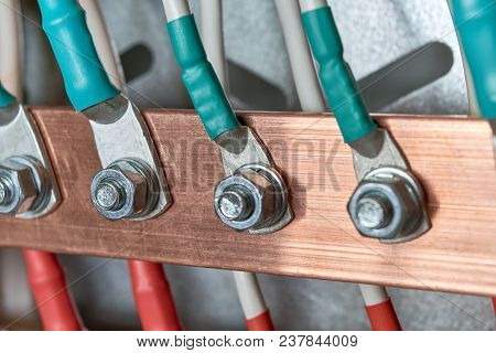 Electric Bus Bars Connected To It By Wires Or Cables. The Cables Are Connected With Cable Lugs And N