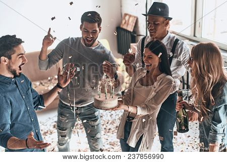 Time For A Birthday Cake. Top View Of Happy Young Man Celebrating Birthday Among Friends While Stand