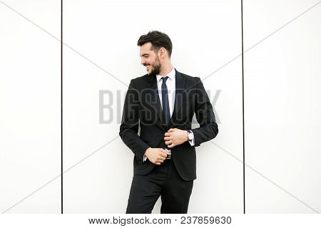 Elegant Man In Suit On White Wall