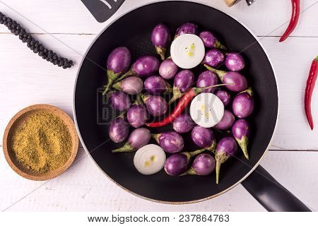 Organic Raw Baby Indian Eggplants In A Pan Top View Flat Lay Raw Eggplants Wooden Background