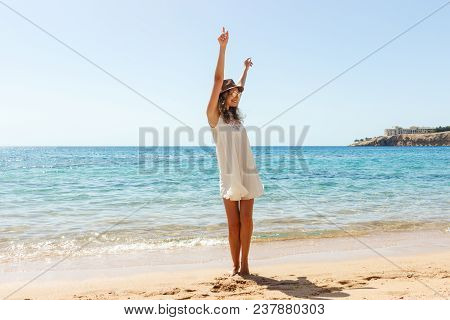 Freedom Woman In Free Happiness Bliss On Beach. Smiling Happy Girl In White Summer Dress In Vacation