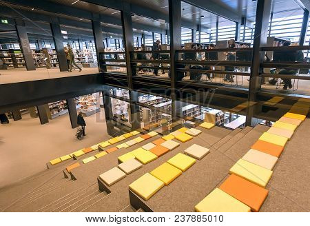 Ghent, Belgium - Mar 30, 2018: Readers Watching The Books Inside The New Public Library De Krook Wit