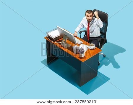 Crazy Boss. Above View Of Businessman Working On Laptop. Young Distressed Frustrated Man Sitting At