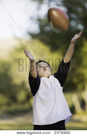 Boy Catching A Football