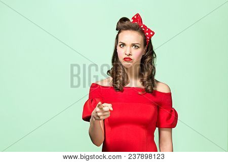 I Choose You And Order. Beautiful Young Woman With Pin-up Make-up At Studio. Serious Pretty Female C