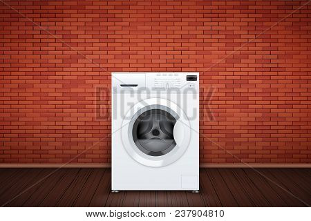 Laundry Room Interior With Washing Machine On Red Brick Wall Background. The Concept Of Modern Equip