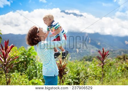 Family Hiking In Mountains And Jungle
