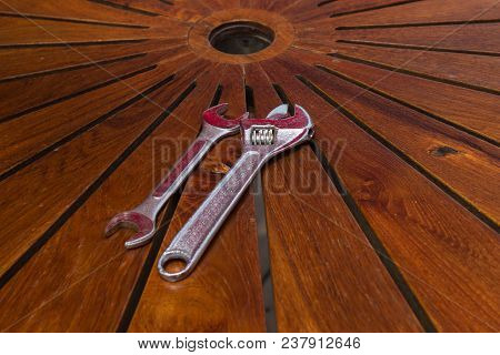 Adjustable Wrench On Wooden Table, Stock Photo