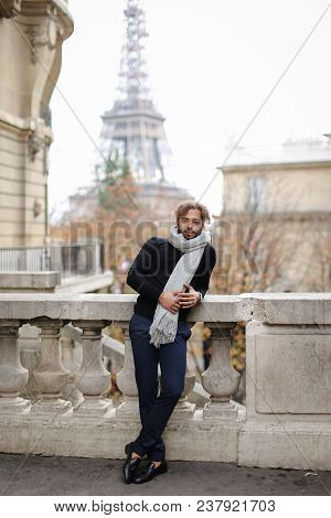 Afro American Handsome Man Standing Near Concrete Railing With Eiffel Tower Background In Paris. Boy