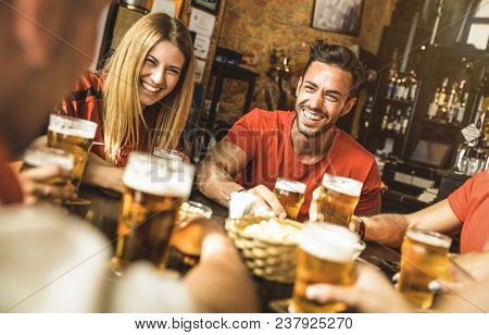 Happy Friends Group Drinking Beer At Brewery Bar Restaurant - Friendship Concept With Young People E