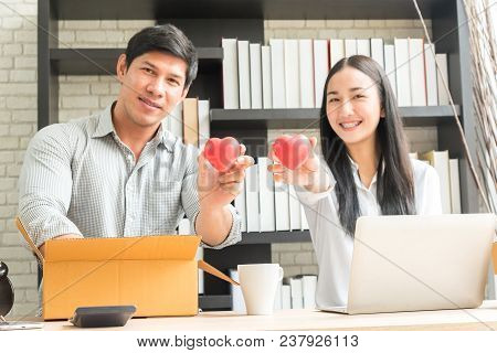 Professional Young Online Shopping Company Team Of Two Co Worker With Box Of Products In Office Back