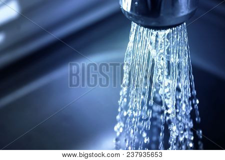 Concept Water Saving At Home, Reducing Use. Water Supply Problems. Water Tap With Flowing Water With