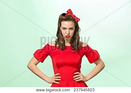 Beautiful Young Woman With Pin-up Make-up And Hairstyle At Studio. Serious And Pretty Female Caucasi
