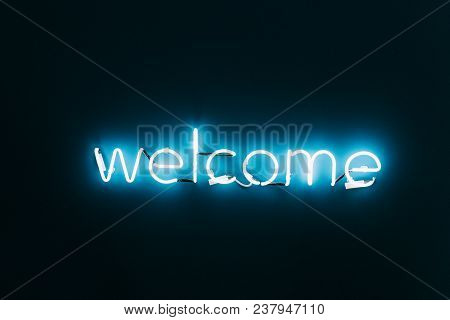 Welcome Neon Sign On Brick Wall Background