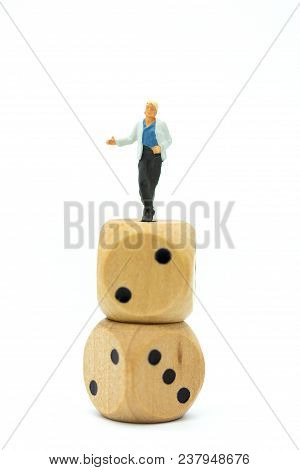 Miniature People : Women Standing On Dice. Image Use For To Solve Problems, Risk Management , Busine