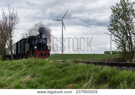 Old Steam Train In A Modern Environment