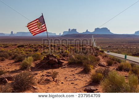 American Flag In Monument Valley Navajo Tribal Reservation Landscape. Forrest Gump Point At Us Highw