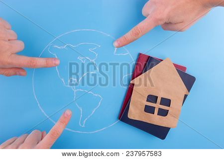 Choose Country To Live Concept. Passports Map House