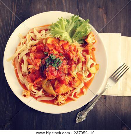 Ribbon Pasta With Arrabiata Sauce. Close Up. Mediterranean Dish. Tagliolini Pasta With Vegetables. C
