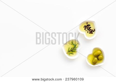 Olive Oil As Famous Product Of Mediterranean Cuisine. Heart Shaped Bowls With Olive Oil With Green O