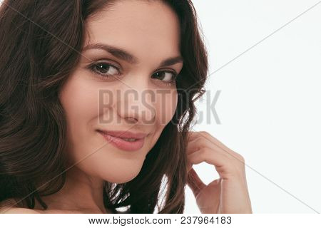 Close Up Portrait Of Charming Brunette Standing In White Studuio. Beauty Concept. Mid Age Woman Over