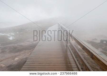 The Wooden Ramp At The Gunnuhver Hot Spring Leads Into The Mist