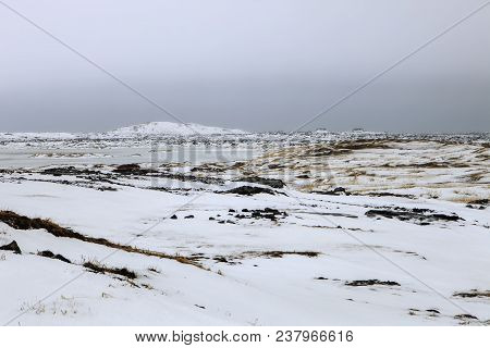 Snow Blankets The Rocky Terrain On The Reykjanes Peninsula In Iceland