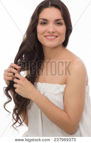 Close Up Image Of White Brunette Gently Touching Her Hair.isolated On White Background. Mid Age Woma