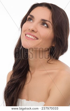 Close Up Of Brunette Model Looking Up With Smile. Isolated On White Background. Mid Age Woman Over 3