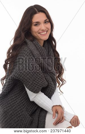 Smiling Brunette Model Sitting Half Turn In Gray Cardigan. Beauty Concept. Mid Age Woman Over 35 Yea