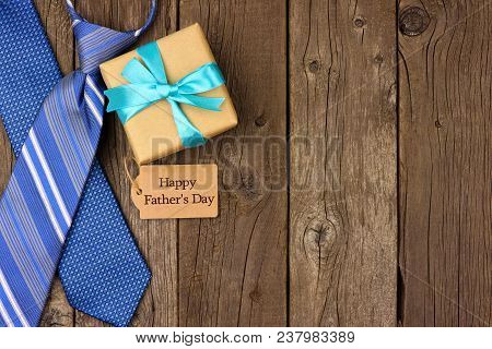 Happy Fathers Day Gift Tag With Gift And Ties Side Border On A Rustic Wood Background. Top View With