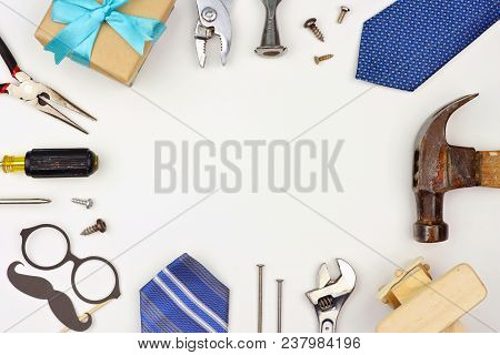 Fathers Day Theme Frame Of Gifts, Decor, Ties And Tools On A White Background. Top View With Copy Sp