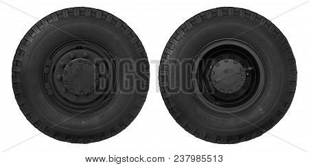 Diagonal View On Tipper Truck Wheels And Tires With Blured Background. Truck Wheel Rim. Truck Chassi