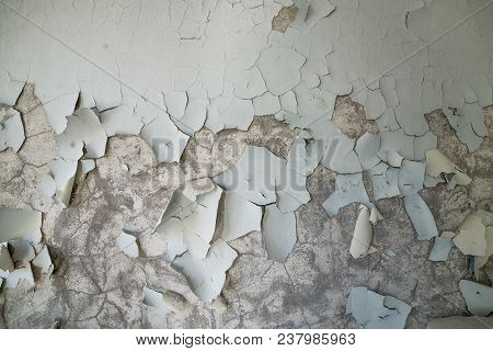 Peeled Paint On The Wall Of A Desolate Building In Abandoned Pripyat. Chernobyl Zone, Ghost Town.