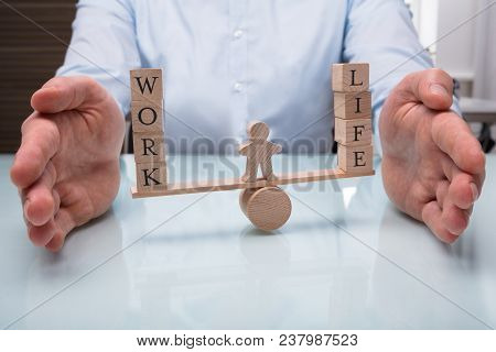 Businessperson Protecting Balance Between Life And Work