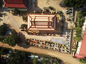 Aerial drone view topdown eagle eye of a traditionnal temple pagoda cemetery in siem reap cambodia asia poster