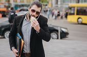 Busy man is in a hurry, he does not have time, he is going to eat snack on the go. Worker eating, drinking coffee, talking on the phone, at the same time. Businessman doing multiple tasks. Multitasking business person poster