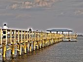 Sureal HDR fishing pier aglow with light poster