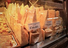 Parmigiano Reggiano. A Gourmet Cheese And Meat Shop In Bologna Sells Authentic Aged Local Italian Pa